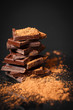 dark chocolate stack and cocoa powder