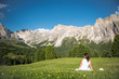 White dressed woman at the Dolomites