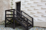 Fototapeta Na drzwi - Wooden staircase at the street with paving stones. Copy space © vpavlyuk