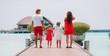 Leinwandbild Motiv Family of four on beach vacation have fun