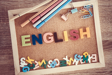colorful ENGLISH word alphabet on a pin board background ,English language learning concept © Cozine