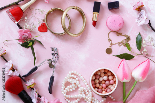 pink background with cosmetics and jewelry for women