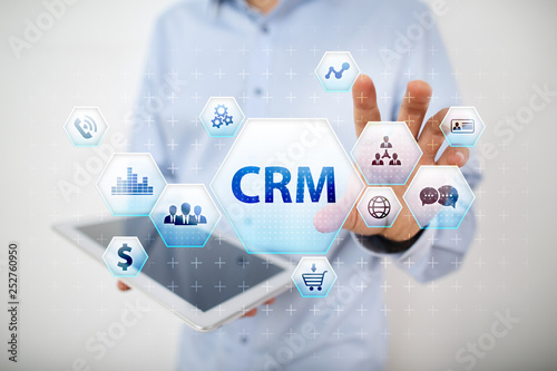 CRM. Customer relationship management concept on virtual screen.