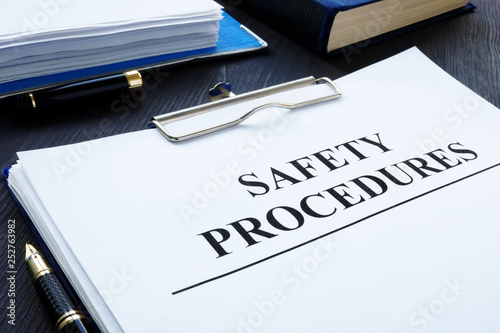 Workplace health and safety Procedures with clipboard.