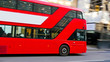 3745_One_of_Londons_red_bus_passing_by_the_street.jpg