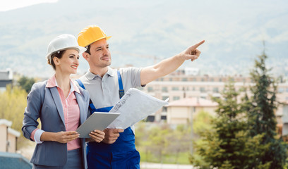 Architect and builder developing ideas for construction project