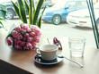 Leinwandbild Motiv Coffee and spring flowers on coffee shop. Good mood concept.