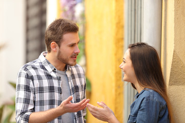 Couple talking standing in a colorful street