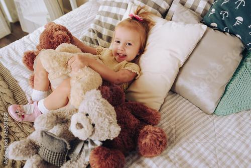happy little girl posing with teddy bear