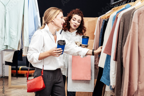 Daughter giving advice for her mother looking for new clothes