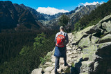 Man tourist backpacks mountain hiking trail Healthy lifestyle