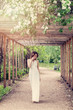 Spring woman in white fashionable dress outdoors portrait, romantic dreams