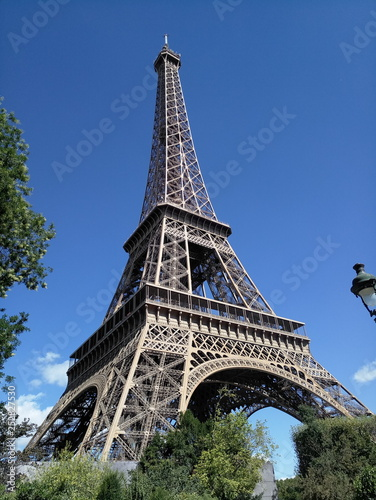 Eiffel Tower on a background of blue sky in Paris