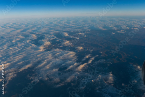 Flight scene plane window view clouds sunset - 252829305