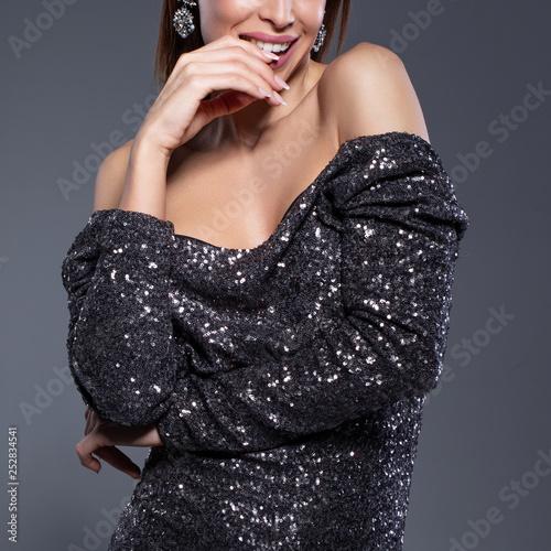 Young sensual woman in clubwear closeup