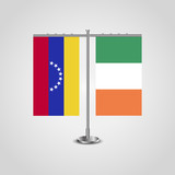 Table stand with flags of Venezuela and Ireland. Two flag. Flag pole. Symbolizing the cooperation between the two countries. Table flags