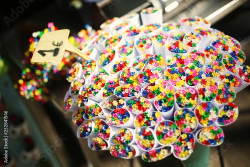 Colorful dry flowers bouquets on the florist shops at La Rambla street market, Barcelona, Spain