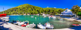 Skopelos island - Picturesque fishing village Agnontas, with traditional tavernas on the beach. Sporades, Greece