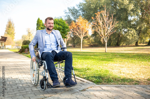 Leinwanddruck Bild Young physically challenged man in his wheelchair
