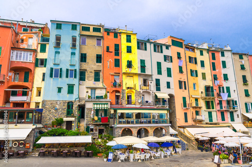 Row of colorful multicolored buildings houses and restaurants of Portovenere coastal town village in harbor of Ligurian sea, Riviera di Levante, National park Cinque Terre, La Spezia, Liguria, Italy