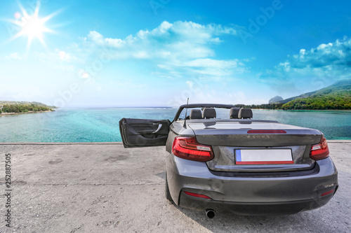Summer car and sea landscape. Free space for your decoration.