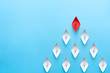 Leinwanddruck Bild - Leadership concept. Red leader paper ship leading among white on blue background. copy space