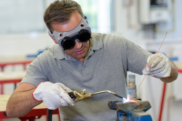 man with goggles in workplace
