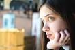 Leinwanddruck Bild - Profile portrait of a beautiful young girl in sadness