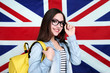 Young student with backpack on British flag background