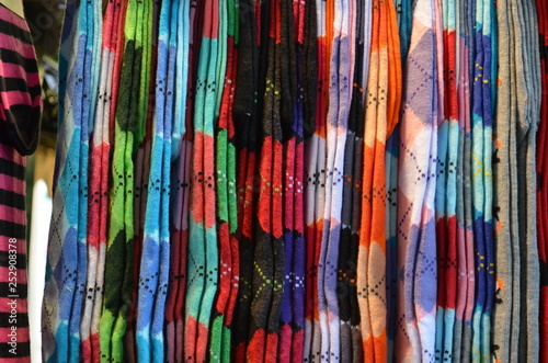 Colourful socks in vertical display at a store stand