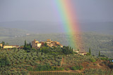 Fototapeta Tęcza - A rainbow above the village of Tignano in the Chianti hills south of Florence in Tuscany © Marco