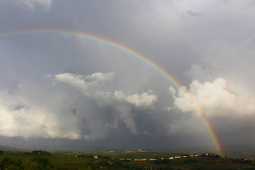 A rainbow above the village of Tignano in the Chianti hills south of Florence in Tuscany