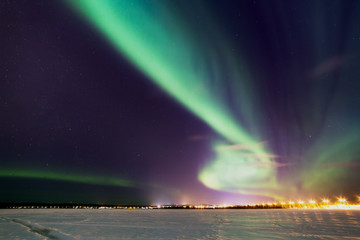 Breathtaking aurora borealis (Northern Lights) in Lapland. The polar Circle, Rovaniemi, Finland.