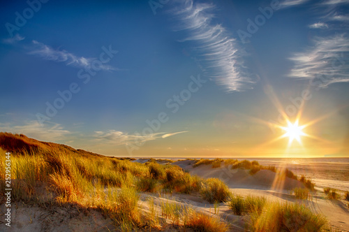 Sunset at the beach on the East Frisian Island Juist in the North Sea, Germany. - 252956344