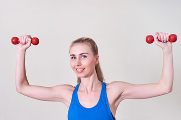 Female athlete doing exercise with dumbbell. Concept of health and body care. © Maxim
