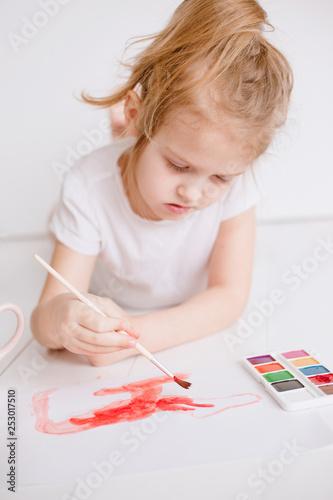 schoolgirl draws paints