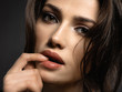 Beautiful woman with brown hair. Attractive model with brown eyes.