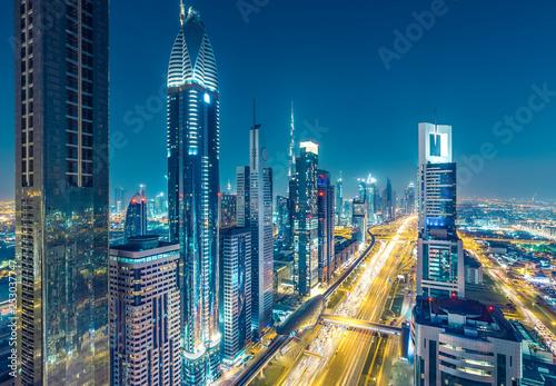 mata magnetyczna Skyscrapers and highways in downtown Dubai, UAE. Nighttime skyline of a big modern city.