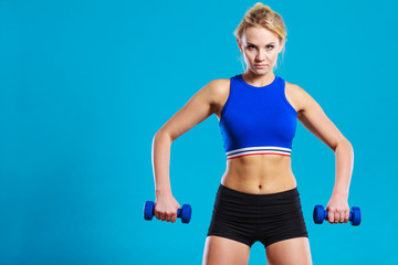 Fit woman lifting dumbbells weights © Voyagerix