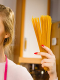 Woman holding long pasta