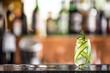 Leinwandbild Motiv Gin tonic cocktail with cucumber on bar counter in pup or restaurant