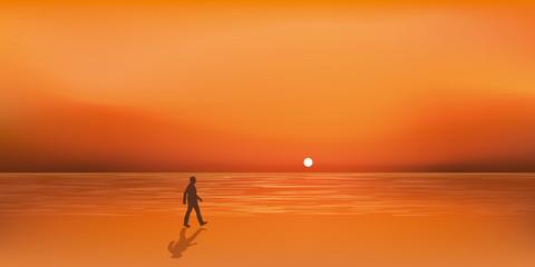 Paysage de bord de mer au soleil couchant avec un homme qui marche seul sur la plage en cherchant à s'évader ou à trouver l'inspiration. © pict rider