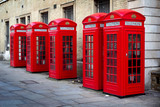 Fototapeta Londyn - Row of old style UK red phone boxes in Covent Garden, London © Neil Lang