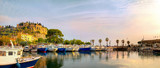 Panoramic landscape with fishing boats in harbour of Cassis at sunset sunlight. France, Provence