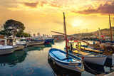 Landscape with fishing boats in harbour of Cassis at sunset. France, Provence