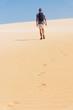Leinwandbild Motiv young backpacker man walking by the desert