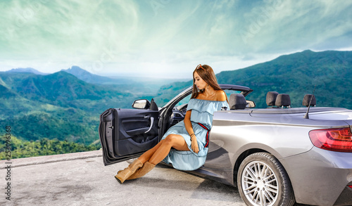 Slim young woman in summer silver car.  - 253096368