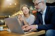 Informal meeting between salesman and manager in modern work space