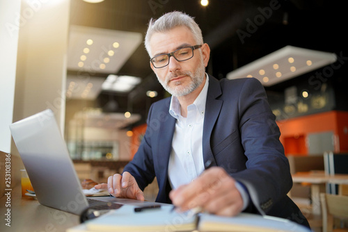 Businessman working during layover in airport