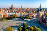 Gdansk, Poland. Old city skyline with Prison Tower, St Mary church, town hall tower, Golden Gate and  Coal Market square (Targ Weglowy).  Aerial view in sunset light